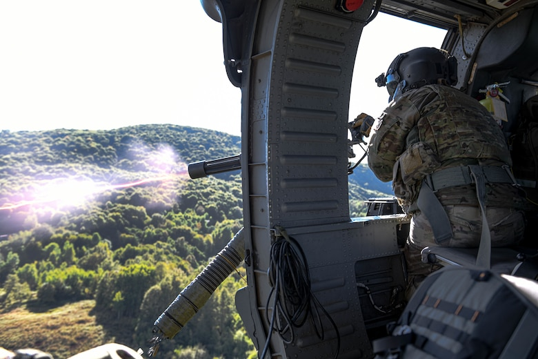 Tech. Sgt. William Mathis, 56th Rescue Squadron special missions aviator evaluator, shoots out of an HH-60G Pave Hawk during a final sortie in Croatia, Sept. 23, 2021. The 56th RQS integrated with the 173rd Army unit from Vicenza and provided top cover during a live-fire exercise. (U.S. Air Force photo by Senior Airman Brooke Moeder)