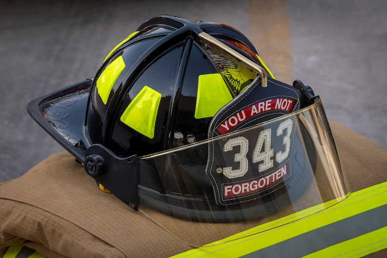 A fire helmet on top of a fire suit is displayed during a Fire Prevention Week proclamation signing Oct. 5, 2021, at Al Udeid Air Base, Qatar.