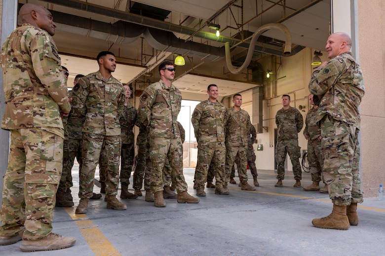 Brig. Gen. Gerald Donohue, 379th Air Expeditionary Wing commander, speaks to Airmen from the 379th Expeditionary Civil Engineer Squadron after signing the Fire Prevention Week proclamation Oct. 5, 2021, at Al Udeid Air Base, Qatar.