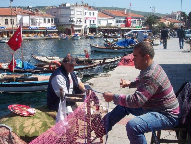 fisherman repairing nets