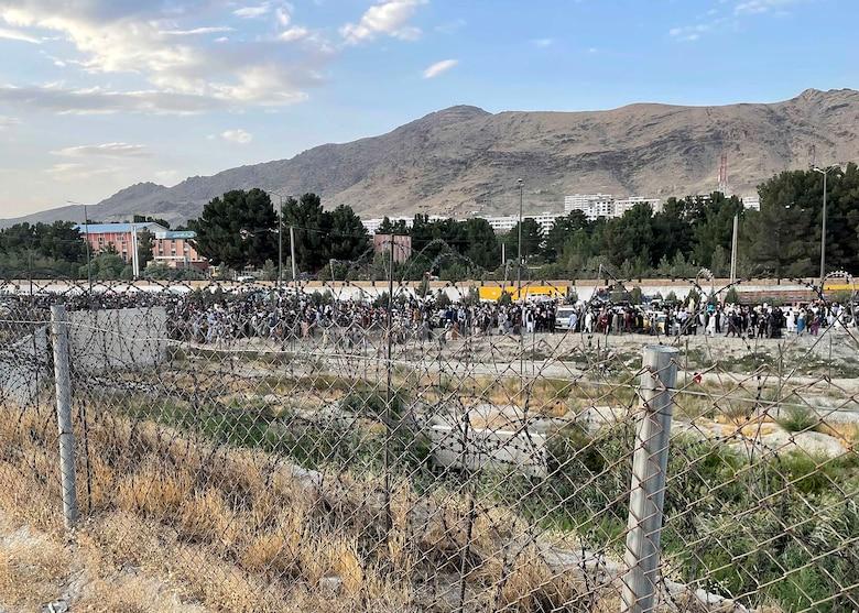 Afghan evacuees stand in line