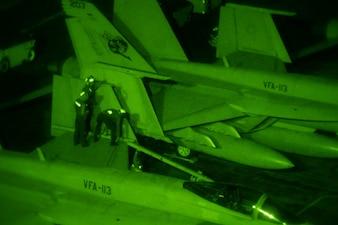 Sailors disassemble the wing of an F/A-18E Super Hornet aboard USS Carl Vinson (CVN 70).