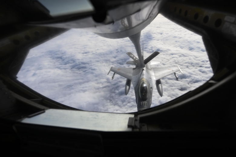 A Romanian air force F-16 Fighting Falcon aircraft receives fuel over Romania from a U.S. Air Force KC-135 Stratotanker aircraft assigned to the 100th Air Refueling Wing, Royal Air Force Mildenhall, England, Oct. 7, 2021. The 100th ARW supports the Air Force's global reach mission by extending the range of U.S. Air Force aircraft in Europe and Africa. (U.S. Air Force photo by Senior Airman Joseph Barron)