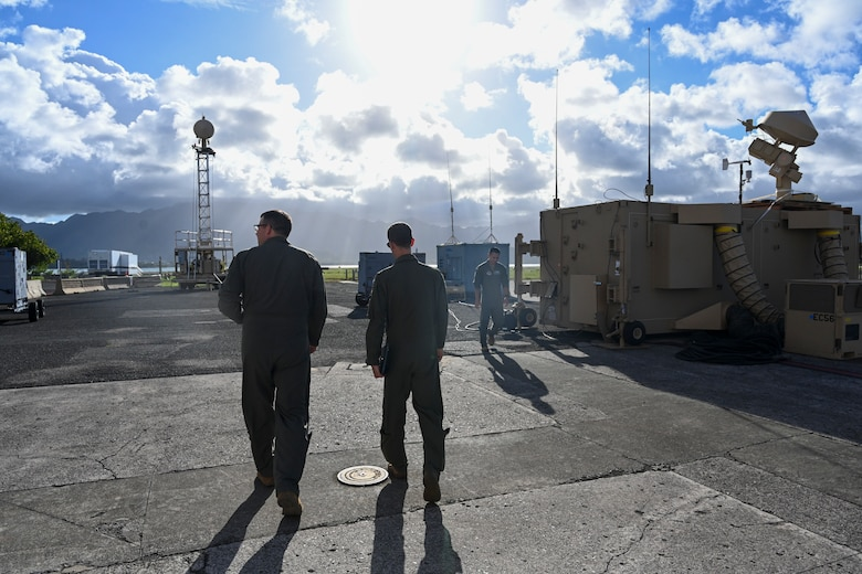 Col. Nicholas Pederson, 49th Wing vice wing commander (left), and Maj. Adam Smith, 16th Training Squadron director of MQ-9 Reaper rapid response operations, walk to the ground control station, Sept. 13, 2021, on Marine Corps Base Hawaii. Pederson visited MCBH to view the operations and how personnel integrated from different platforms - in an effort to continue defense and security of our nation. (U.S. Air Force photo by Airman 1st Class Adrian Salazar)