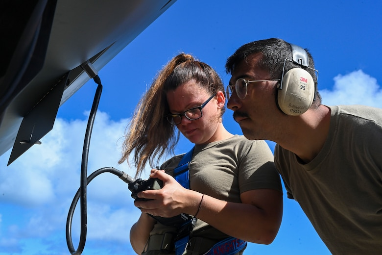 Staff Sgt. Aubree Kovalick, 49th Aircraft Maintenance Squadron avionics technician, and Airman 1st Class Brandon Navarrete, 49th AMXS special avionics technician, load GPS keys to an MQ-9 Reaper Sept. 15, 2021, on Marine Corps Base Hawaii. The purpose of Exercise Agile Combat Employment Reaper is to demonstrate the MQ-9 assets and the ability to rapidly mobilize and integrate across multiple domains. (U.S. Air Force photo by Airman 1st Class Adrian Salazar)