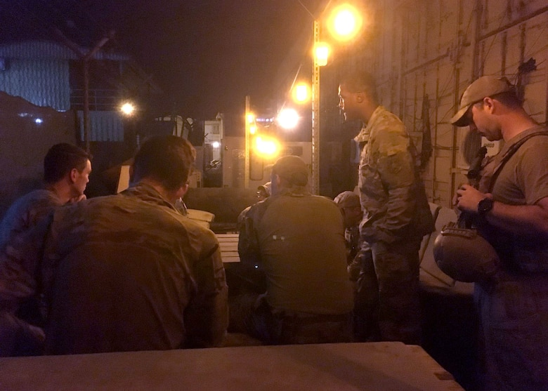 Airmen conduct a mission briefing
