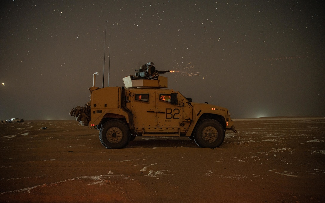 Marines assigned to Weapons Company, Battalion Landing Team 1/1, 11th Marine Expeditionary Unit, fire an M240B mounted on a Joint Light Tactical Vehicle during a live-fire range at Camp Buehring, Kuwait, Oct. 7, 2021. The 11th MEU and Essex Amphibious Ready Group are deployed to the U.S. 5th Fleet area of operations in support of naval operations to ensure maritime stability and security in the Central Region, connecting the Mediterranean and Pacific through the Western Indian Ocean and three strategic choke points.