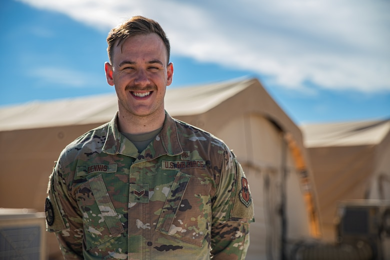 Senior Airman Ethan Dennis, a bioenvironmental engineer attached to Task Force Holloman, poses for a photo on Holloman Air Force Base, New Mexico, Oct. 7, 2021. The Department of Defense, through U.S. Northern Command, and in support of the Department of Homeland Security, is providing transportation, temporary housing, medical screening, and general support for at least 50,000 Afghan evacuees at suitable facilities, in permanent or temporary structures, as quickly as possible. This initiative provides Afghan personnel essential support at secure locations outside Afghanistan. (U.S. Army photo by Pfc. Anthony Sanchez)