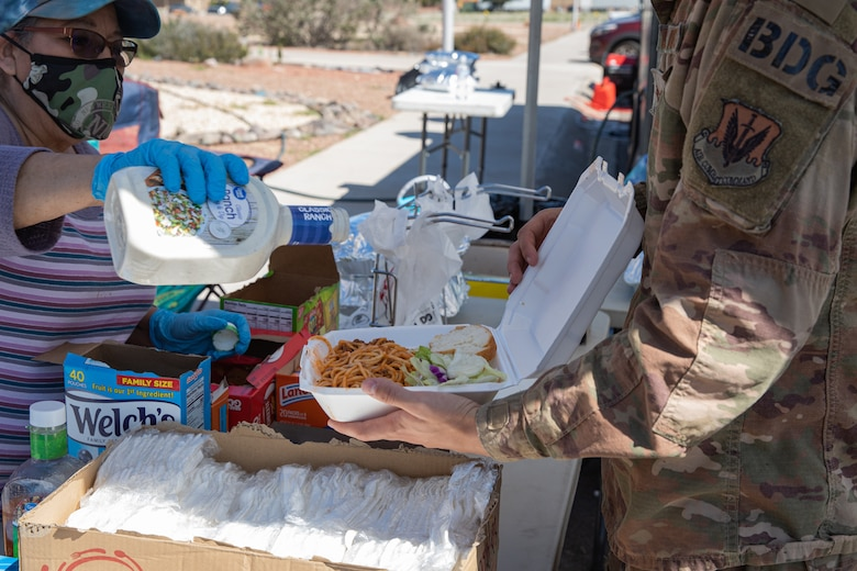 Volunteers from Mountain View Church hand out free meals to Task Force Holloman members at Holloman Air Force Base, New Mexico, Oct. 5, 2021. The Department of Defense, through the U.S. Northern Command, and in support of the Department of State and Department of Homeland Security, is providing transportation, temporary housing, medical screening, and general support for at least 50,000 Afghan evacuees at suitable facilities, in permanent or temporary structures, as quickly as possible. This initiative provides Afghan evacuees essential support at secure locations outside Afghanistan. (U.S. Army photo by Spc. Nicholas Goodman)