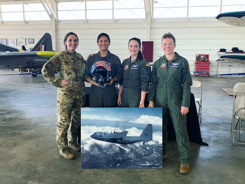A photo of Airmen posing for a group photo.