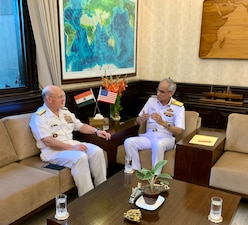 Chief of Naval Operations (CNO) Adm. Mike Gilday, left, meets with Indian navy Chief of Naval Staff Adm. Karambir Singh.