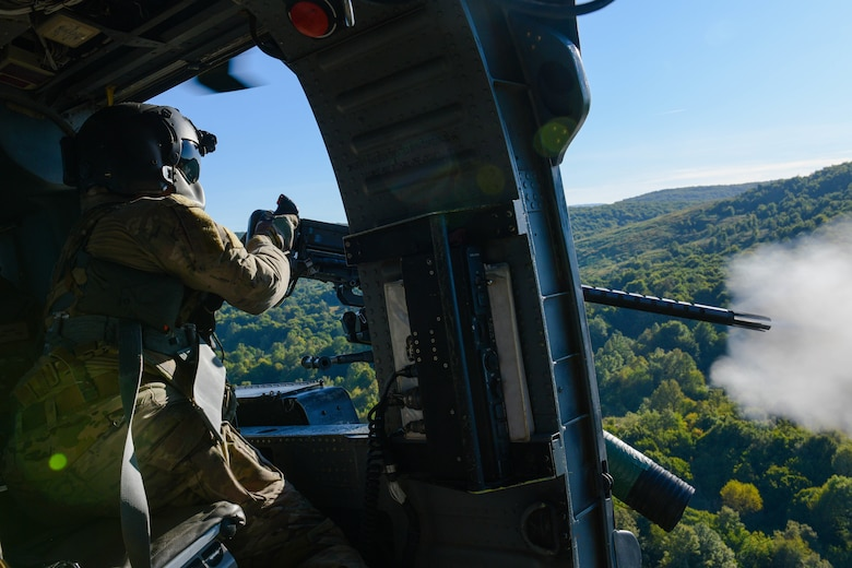 U.S. Air Force Staff Sgt. Kinga Hudson, 56th Rescue Squadron special missions aviator, performs training during a training sortie in Croatia Sept. 23, 2021. The HH-60G A6212 helicopter completed its final sortie before retirement and three crew members completed .50 caliber and mini gun training during the sortie. (U.S. Air Force photo by Senior Airman Brooke Moeder)