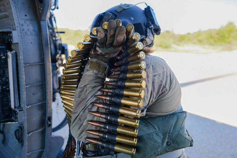 U.S. Air Force Staff Sgt. Kinga Hudson, 56th Rescue Squadron special missions aviator, loads ammunition onto an HH-60G Pave Hawk in Croatia, Sept. 23, 2021. Three crew members completed .50 caliber and mini gun training during the sortie. (U.S. Air Force photo by Senior Airman Brooke Moeder)