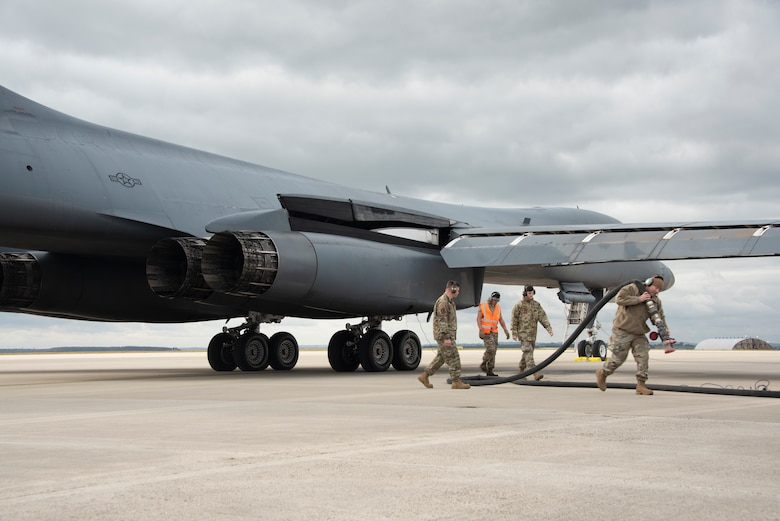 Two B-1B Lancers, from Dyess Air Force Base's 9th Expeditionary Bomb Squadron currently operating from Royal Air Force Fairford, England, conduct hot-pit refueling using the innovative Versatile Integrated Partner Equipment Refueling (VIPER) kit, at Spangdahlem Air Base, Germany, Oct. 11, 2021. This was in support of European Command's Bomber Task Force 22-1 mission support series using the VIPER kit, a hot-pit refuel tool supporting Agile Combat Employment operations.