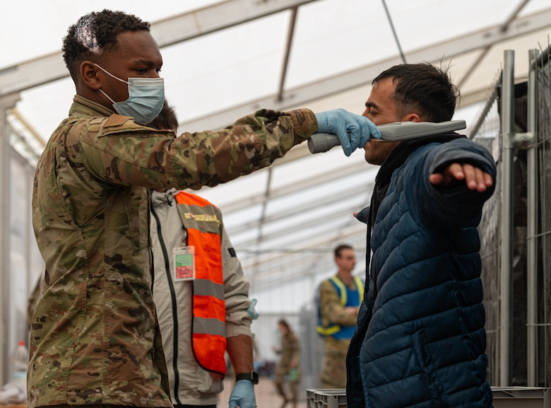 Airman performs security check.