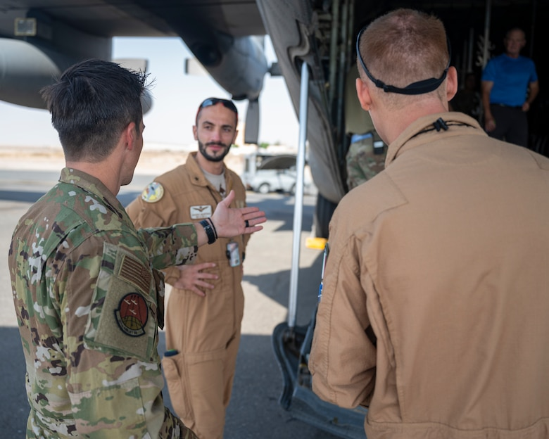 U.S. Air Force Maj. Scott Graves, a pilot assigned to the 779th Expeditionary Airlift Squadron, interacts with members of the Italian Air Force during a C-130H Hercules tour at Ali Al Salem Air Base, Kuwait, Oct. 9, 2021.