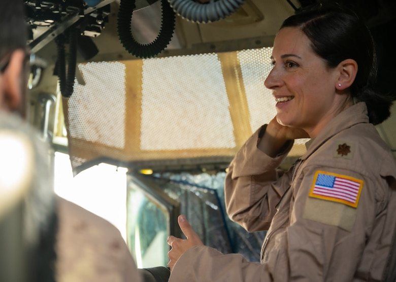 U.S. Air Force Maj. Natalie Marshall, a pilot assigned to the 779th Expeditionary Airlift Squadron, interacts with visitors during a C-130H Hercules tour at Ali Al Salem Air Base, Kuwait, Oct. 9, 2021.