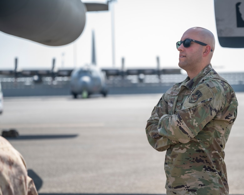 U.S. Air Force Staff Sgt. Michael Roybal, a contracting officer assigned to the 386th Expeditionary Contracting Squadron, observes a C-130H Hercules during a tour at Ali Al Salem Air Base, Kuwait, Oct. 9, 2021.