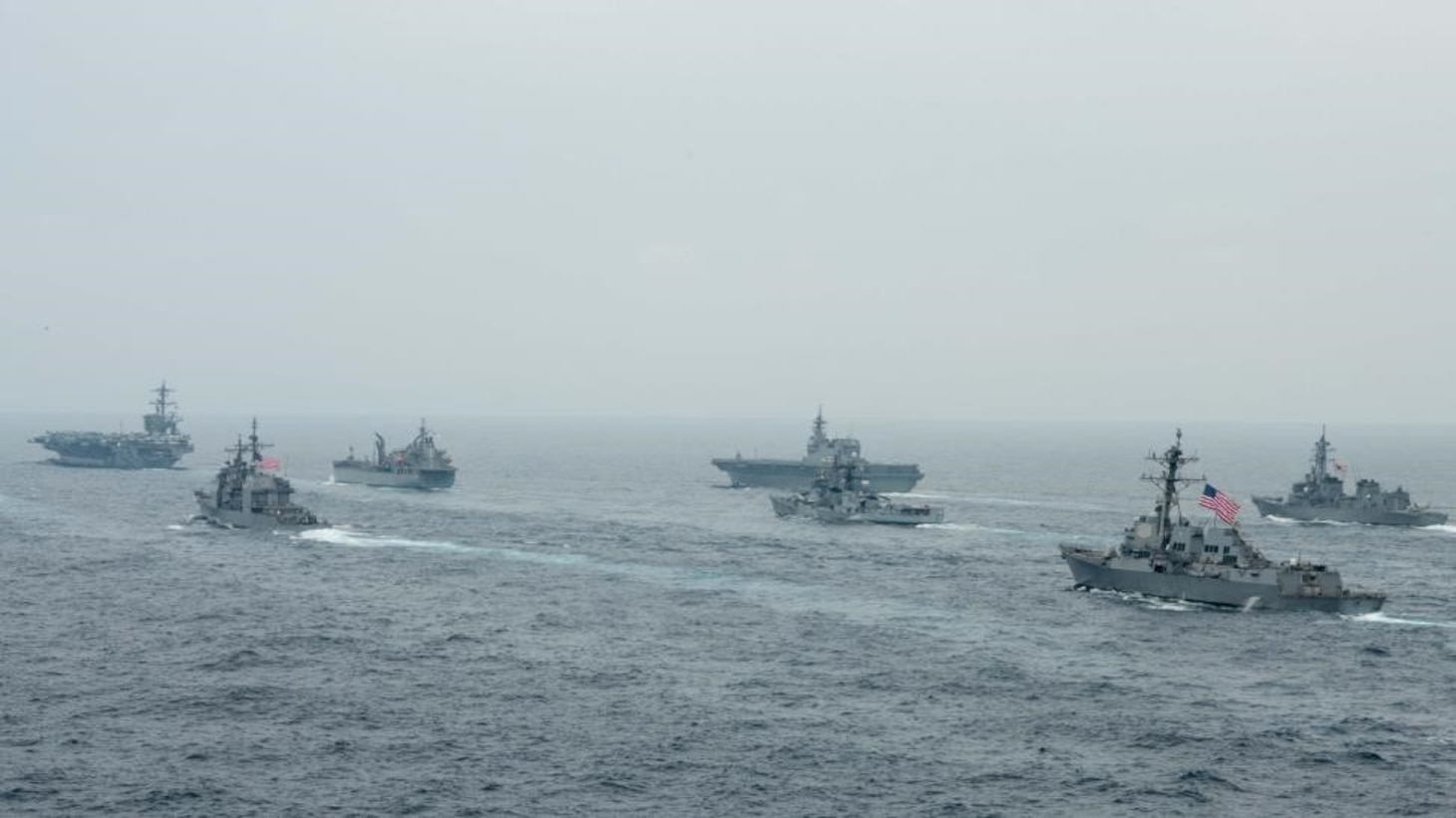 BAY OF BENGAL (Oct. 12, 2021)  U.S. Navy Nimitz-class aircraft carrier USS Carl Vinson (CVN 70), U.S. Navy Ticonderoga-class guided-missile cruiser USS Lake Champlain (CG 57), Royal Australian Navy fleet replenishment vessel HMAS Sirius (O 266), Japan Maritime Self-Defense Force (JMSDF) Izumo-class helicopter destroyer JS Kaga (DDH 184), Royal Indian Navy Rajput-class destroyer INS Ranvijay (D55), U.S. Navy Arleigh Burke-class guided-missile destroyer USS Stockdale (DDG 106) and JMSDF Murasame-class destroyer JS Murasame (DD 101) transit the Bay of Bengal as part of MALABAR 2021, Oct. 12, 2021. MALABAR 2021 is a maritime exercise designed to improve integration, address common maritime security priorities and concerns, enhance interoperability and communication, and strengthen enduring relationships between the Royal Australian Navy, Royal Indian Navy, JMSDF, and U.S. maritime forces. (U.S. Navy photo by Mass Communication Specialist 2nd Class Russell Lindsey)
