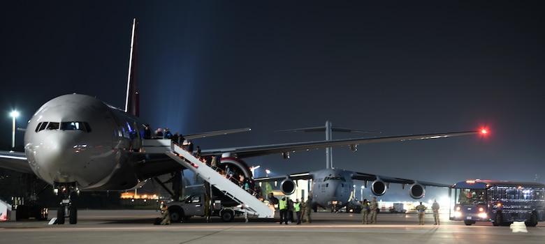 Passengers board outbound flights.