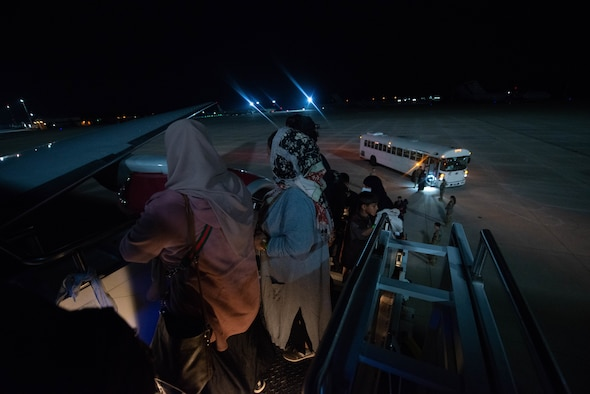 Evacuees board flight outbound from Ramstein Air Base.