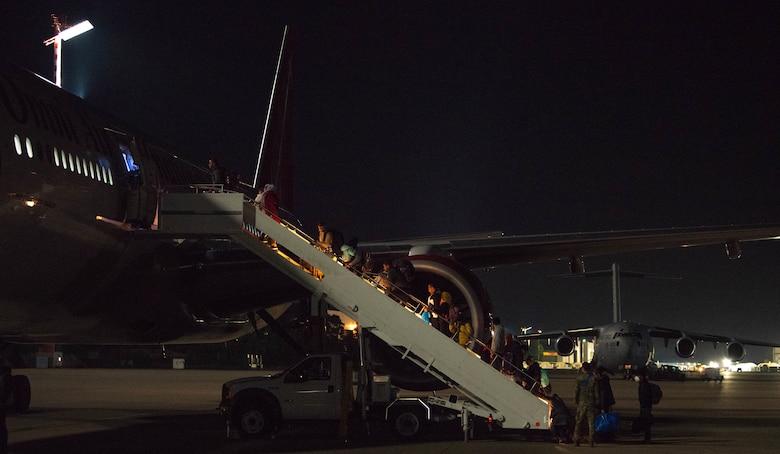 Passengers board outbound flight.