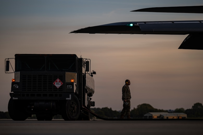 A fuels specialist assigned to the 9th Expeditionary Bomb Squadron, stands by while a B-1B Lancer is being refueled at RAF Fairford, United Kingdom, Oct 11, 2021. Hot pit refueling is the refueling of an aircraft without turning off the engines. These refueling operations give aircrew the ability to conduct multiple mission sets before needing to turn the aircraft over to undergo routine maintenance. (U.S. Air Force photo by Senior Airman Colin Hollowell)