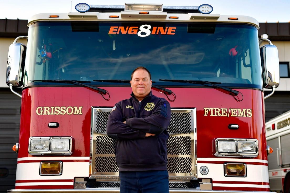 John Ireland, Grissom fire chief, poses in front of a fire truck at Grissom Air Reserve Base, Indiana, Oct. 13, 2021. Ireland won the Indiana Emergency Responders Conference Fire Chief of the Year award. (U.S. Air Force photo by Staff Sgt. Jeremy Blocker)
