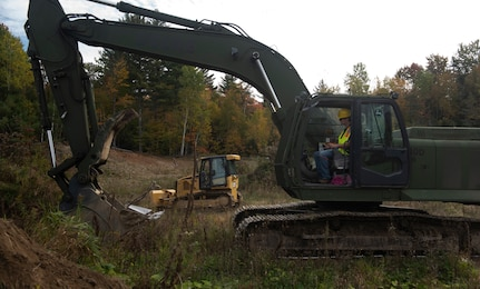 Students from the Center for Technology Essex operate heavy equipment under supervision from Vermont National Guard Soldiers during a visit to the Camp Ethan Allen Training Site in Jericho, Vermont, on Oct. 12, 2021. (U.S. Army National Guard photo by Don Branum)