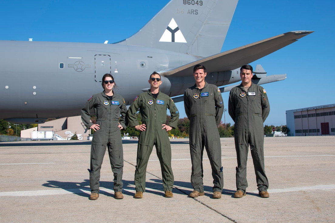 U.S. Air Force aircrew of the KC-46 Pegasus flyover team for the funeral of U.S. Army Air Forces Lt. Earnest Vienneau, 97th Bombardment Group (BW), stands next to their aircraft at Pease Air National Guard Base, New Hampshire, Oct. 8, 2021. Over time, the 97th BW  became the 97th Air Mobility Wing that these Airmen are members of. (U.S. Air Force photo by Staff Sgt. Cody Dowell)