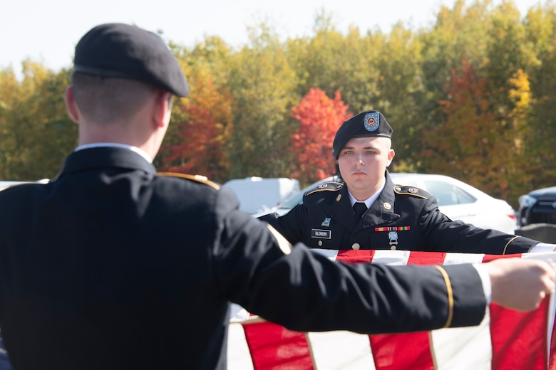 Members of the U.S. Army Honor Guard team from Fort Drum, New York, fold the American Flag for the funeral of U.S. Army Air Forces 2nd Lt. Ernest Vienneau, former 97th Bombardment Group pilot, at Millinocket, Maine, Oct. 9, 2021. The flag is ceremonially folded 13 times in a specific manner, with each fold having its own specific meaning. (U.S. Air Force photo by Staff Sgt. Cody Dowell)