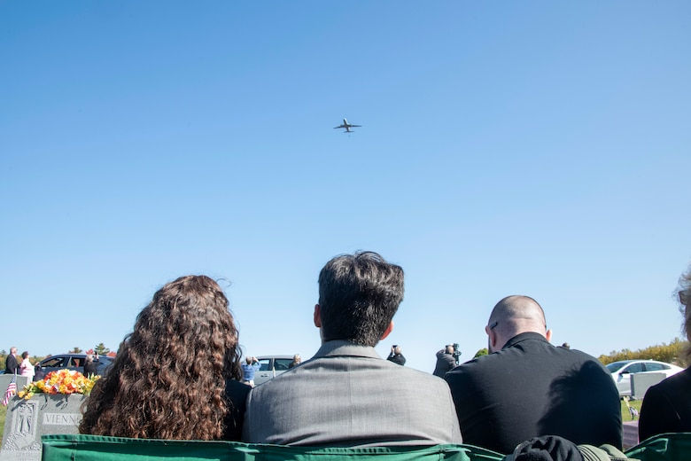 The family of U.S. Army Air Forces 2nd Lt. Ernest Vienneau, former 97th Bombardment Group (BG) pilot, watches as a KC-46 Pegasus from the 97th Air Mobility Wing (AMW) approaches in the distance at Millinocket, Maine, Oct. 9, 2021. The 97th BG at the time of Vienneau's service was in Amendola, Italy, and has since changed its name and location to the 97th AMW in Altus, Oklahoma. (U.S. Air Force photo by Staff Sgt. Cody Dowell)