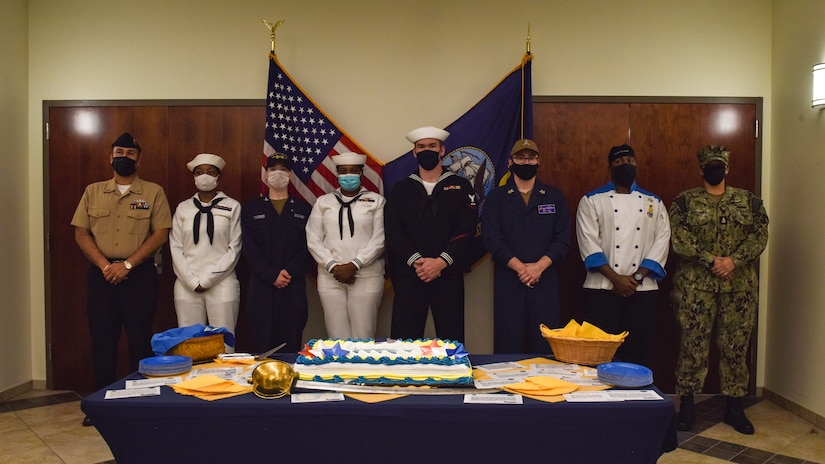 Sailors stand in attendance to celebrate the U.S. Navy's 246th birthday at Joint Base McGuire-Dix-Lakehurst, N.J., Oct. 13, 2021. A traditional cake-cutting ceremony was held at the Lakehurst Flight Deck Community Center. (U.S. Air Force Photo by Staff Sergeant Shay Stuart)
