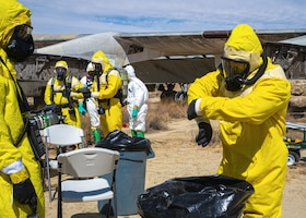 """Airmen from the Explosive Ordnance Disposal Flight, 812th Civil Engineer Squadron, remove their PPE during a """"Broken Arrow"""" training exercise on Edwards Air Force Base, California, Sept. 28. (Air Force photo by Katherine Franco)"""