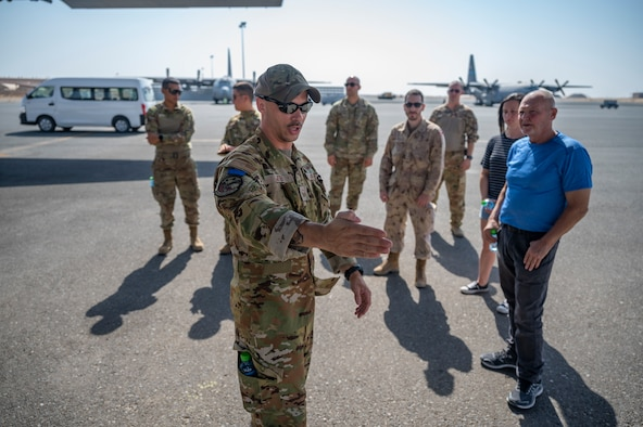 U.S. Air Force Master Sgt. Andrew Jeter, a loadmaster assigned to the 779th Expeditionary Airlift Squadron, interacts with visitors during a C-130H Hercules tour at Ali Al Salem Air Base, Kuwait, Oct. 9, 2021.