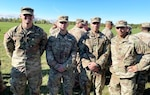 From left, New York Army National Guard Spcs. William Neumeister and Nicholas Weber, Sgt. Alexander Sonneville and Sgt. 1st Class Ryan Blount at Fort Drum, New York, Oct. 1, 2021, after earning the Expert Soldier Badge. The four are the first New York Army National Guard Soldiers to earn the new skills badge.