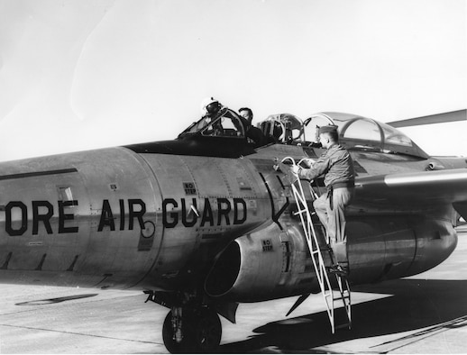 Oregon Air National Guard 123rd Fighter-Interceptor Squadron F-89J Scorpion pilot Bradford A. Newell sits in the front cockpit with hands by his helmet in this undated picture from the early 1960's, as another crewmember, probably the aircraft's radar observer, stands on the ladder.  Perhaps they have just finished a sortie in this natural-metal finish Northrop F-89J Scorpion fighter-interceptor.  (142nd Wing History Archive)