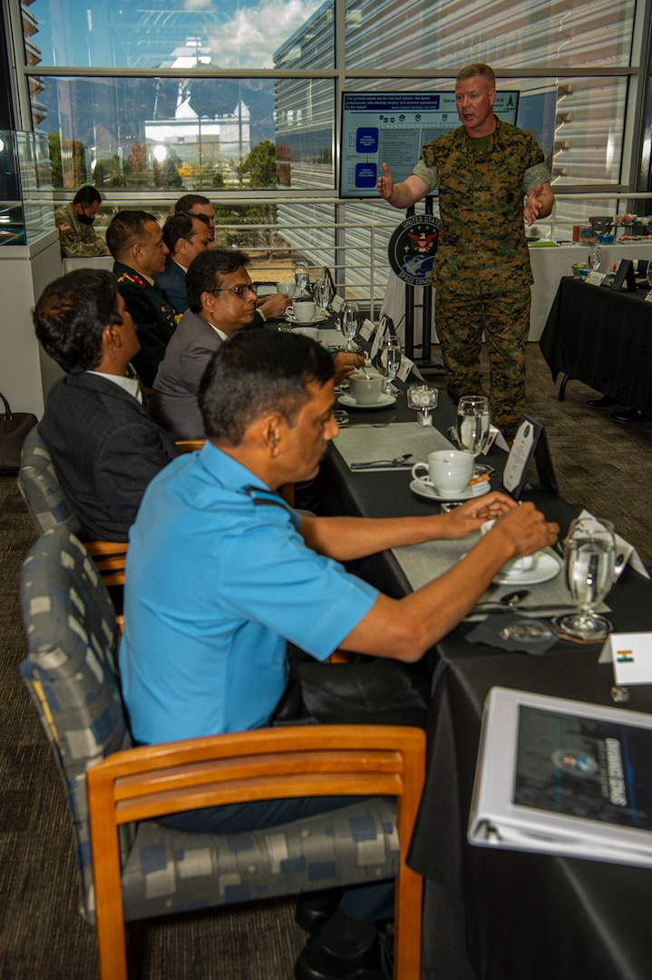 U.S. military and Indian government officials meet.