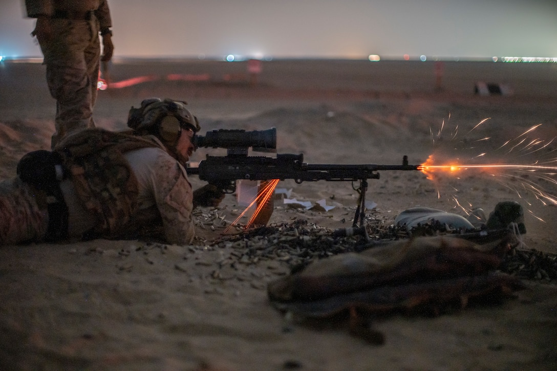 Hospital Corpsman 1st Class Simon Trujillo, a special amphibious reconnaissance corpsman assigned to the All Domain Reconnaissance Detachment, 11th Marine Expeditionary Unit, fires an M240B machine gun during a live-fire range at Udari Range Complex, Kuwait, Oct. 3, 2021. The 11th MEU and Essex Amphibious Ready Group are deployed to the U.S. 5th Fleet area of operations in support of naval operations to ensure maritime stability and security in the Central Region, connecting the Mediterranean and Pacific through the Western Indian Ocean and three strategic choke points.