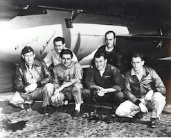 The Bell X-1 team pose for a group photo: (from left to right) Ed Swindell, Robert Cardenas, Bob Hoover, Chuck Yeager, Dick Frost, Jack Ridley, at Edwards Air Force Base, California. (Photo courtesy of Air Force Test Center History Office)