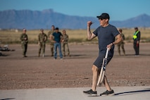 Brig. Gen. Daniel Gabrielli, Task Force-Holloman commander, celebrates during a cricket game between U.S. service members and Afghan evacuees at Aman Omid Village on Holloman Air Force Base, New Mexico, Oct. 9, 2021. The Department of Defense, through U.S. Northern Command, and in support of the Department of Homeland Security, is providing transportation, temporary housing, medical screening, and general support for at least 50,000 Afghan evacuees at suitable facilities, in permanent or temporary structures, as quickly as possible. This initiative provides Afghan personnel essential support at secure locations outside Afghanistan. (U.S. Army photo by Pfc. Anthony Sanchez)