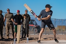 Brig. Gen. Daniel Gabrielli, Task Force-Holloman commander, bats during a cricket game between U.S. service members and Afghan evacuees at Aman Omid Village on Holloman Air Force Base, New Mexico, Oct. 9, 2021. The Department of Defense, through U.S. Northern Command, and in support of the Department of Homeland Security, is providing transportation, temporary housing, medical screening, and general support for at least 50,000 Afghan evacuees at suitable facilities, in permanent or temporary structures, as quickly as possible. This initiative provides Afghan personnel essential support at secure locations outside Afghanistan. (U.S. Army photo by Pfc. Anthony Sanchez)