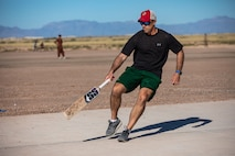 Lt. Col. Taylor Francis, Task Force-Holloman director of operations deployed from Seymour Johnson Air Force Base, North Carolina, rounds the cricket field during a cricket game between U.S. service members and Afghan evacuees at Aman Omid Village on Holloman Air Force Base, New Mexico, Oct. 9, 2021. The Department of Defense, through U.S. Northern Command, and in support of the Department of Homeland Security, is providing transportation, temporary housing, medical screening, and general support for at least 50,000 Afghan evacuees at suitable facilities, in permanent or temporary structures, as quickly as possible. This initiative provides Afghan personnel essential support at secure locations outside Afghanistan. (U.S. Army photo by Pfc. Anthony Sanchez)