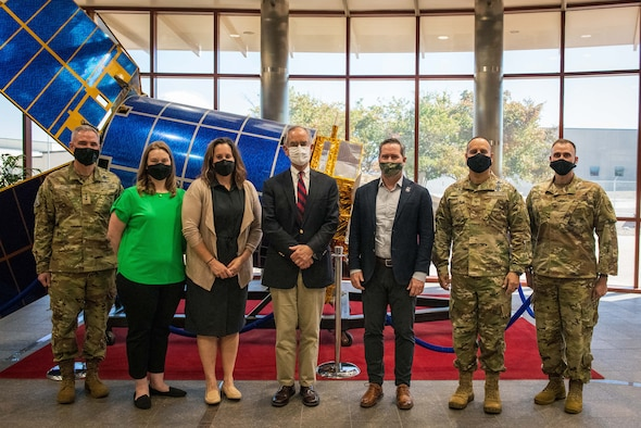 Congressman Jim Cooper, the U.S. Representative for Tennessee's 5th congressional district, Congressman Michael Waltz, the U.S. Representative for Florida's 6th congressional district, and U.S. Space Force leadership pose for a photo in front of a static Defense Support Program Satellite on Oct. 13, 2021, in the Mission Control Station lobby on Buckley Space Force Base, Colo. After a brief on Space Delta 4's overall mission, the congressmen toured the Space Based Infrared Satellites operations floor and the Overhead Persistent Infrared Battlespace Awareness Center. (U.S. Space Force photo by Senior Airman Joshua T. Crossman)