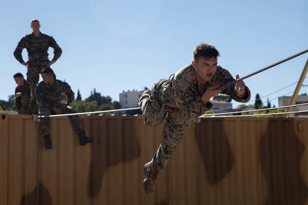 U.S Marine Corps Cpl. Devin Sims, a native of Athens, Ala., and a team leader with 1st Battalion, 6th Marine Regiment, 2d Marine Division, participates in an obstacle course during Exercise Baccarat