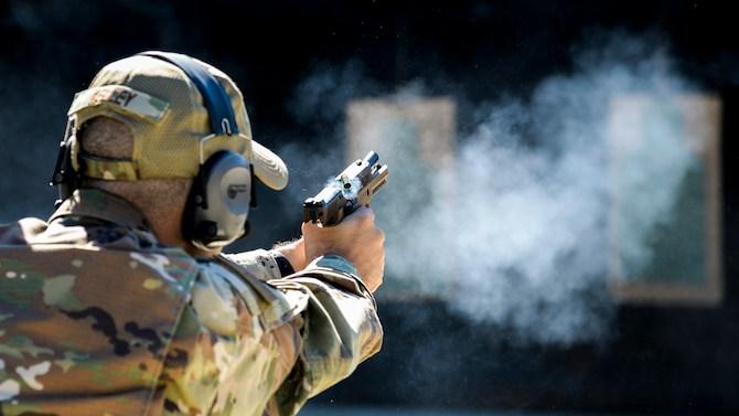 U.S. Air Force Senior Master Sgt. Justin Kelley, 177th Operations Squadron C2 operations senior enlisted leader, fires a Sig Sauer P320-M18 handgun Sep. 24, 2021, at the FAA William J. Hughes Technical Center, Egg Harbor Township, N.J. Members of the 177th FW went to the range to qualify for the M18 and gain the perspective of the Airmen who will carry it. (U.S. Air National Guard photo by Senior Airman Hunter Hires)