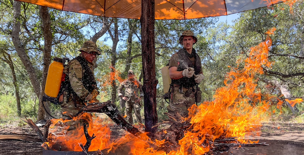 Survival, evasion, resistance and escape instructors and trainees participate in the SERE Specialist Training Orientation Course at Joint Base San Antonio-Camp Bullis, Texas, Sept. 21, 2021. The SERE training orientation is a 15-day course designed to gauge the trainees' potential success in the SERE pipeline. The trainees are evaluated on their physical fitness, leadership and followership abilities, time management, speaking ability and commitment to becoming a SERE specialist. (U.S. Air Force photo by Brian G. Rhodes)