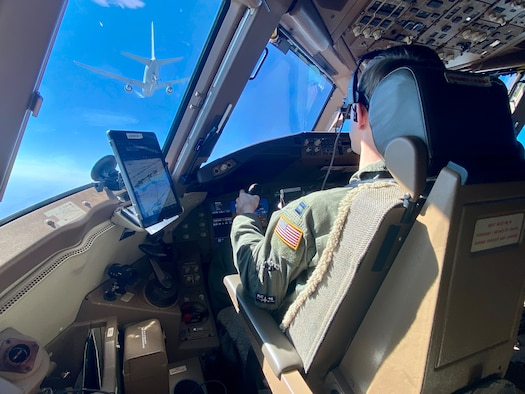Captain Taylor Johnson, KC-46A Pegasus mission pilot, approaches another KC-46A assigned to McConnell Air Force Base, Kansas, Sep. 23, 2021. The alert launch and response was the first to be conducted with a KC-46 and tested the capabilities of the crew to mobilize and respond in the event of an attack or emergency. (U.S. Air Force courtesy photo)