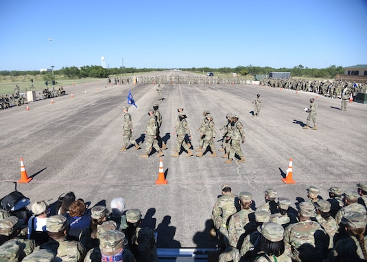The 316th Training Squadron black ropes conduct a regulation sequence during the regulation portion of the 17th Training Group drill competition.