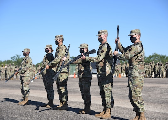 The 315th Training Squadron drill team conducts an exhibition routine during the 17th Training Group drill competition